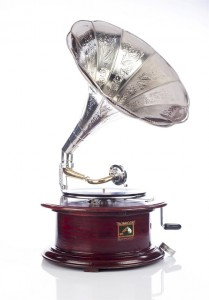 Round (circular) gramophone with a crank in brown colour (mahogany) - patephone